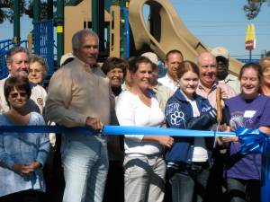 Maura Hanlon and her two daughters officially cut the ribbon on the barrier-free playground.